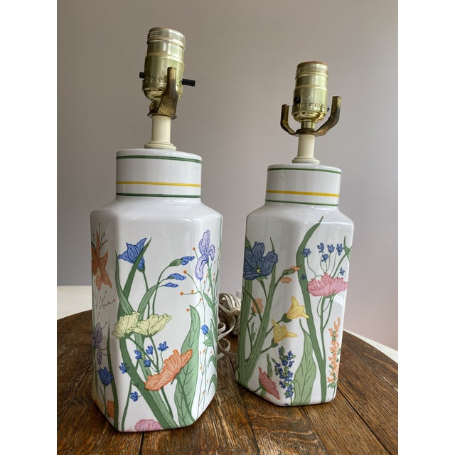 A creamy white base sets the cheery tone for these vintage porcelain table lamps. Each one is adorned with a lovely...