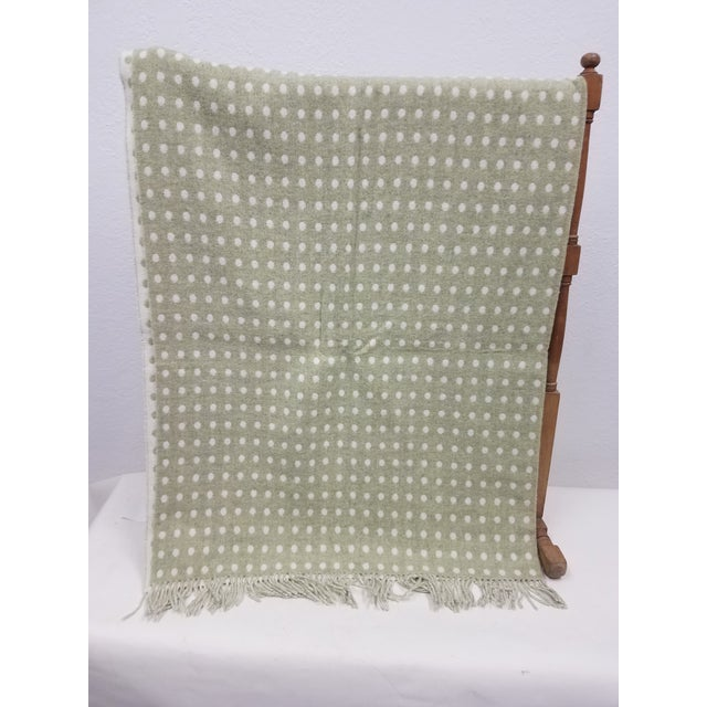 Merino Wool Throw Light Green Polka Dot - Made in England A versatile throw in a polka dot design made from soft 100%...