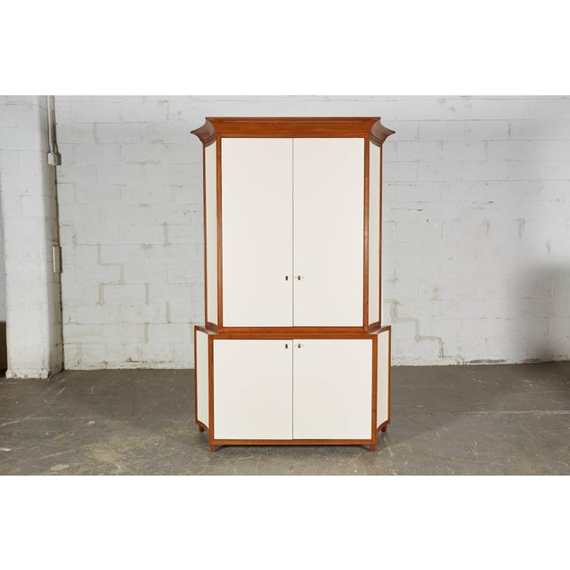 Deco inspired two part cabinet custom made to house a flat screen TV and coordinating equipment. Each part with elegantly...