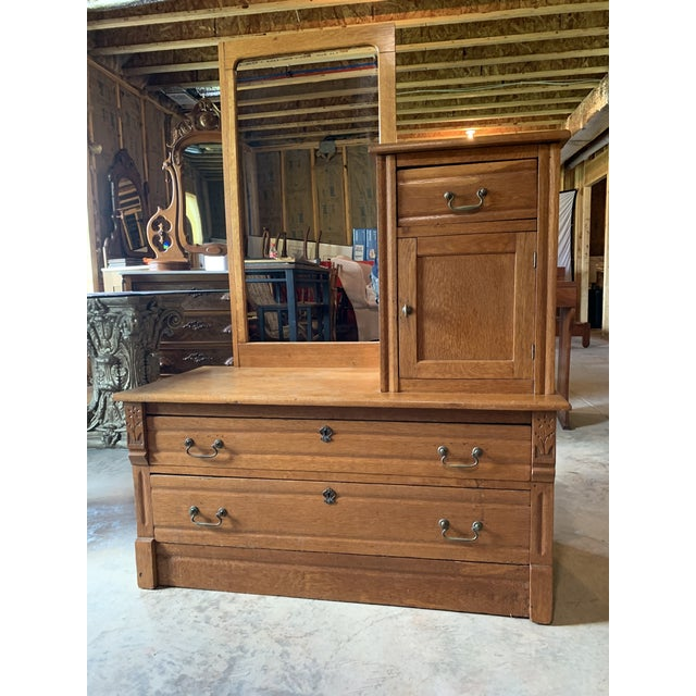 Turn of the century Gentleman's carved wood wardrobe with static mirror, upper drawer/ cabinet storage with floral carved...