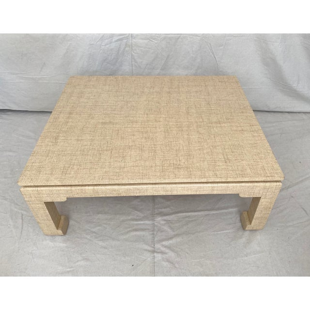 """Grasscloth wrapped coffee table in low """"ming"""" style profile. Wrapped in natural tone seagrass/grasscloth woven material. A..."""