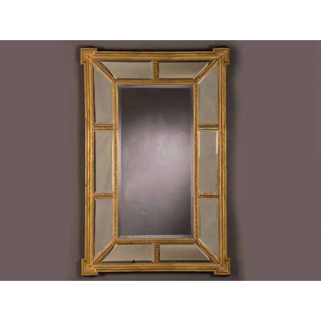 A handsome gold leaf frame in the manner designed by famed English architect Robert Adam (1728-1792) that encloses the...