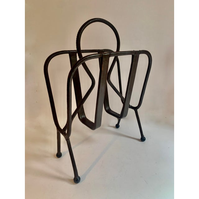 French Designer, Jacques Adnet is best known for impeccable designs that bring leather, function and design together. The...