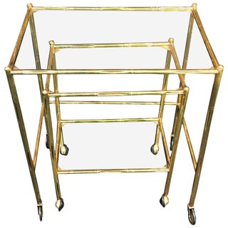 EXCEPTIONAL PAIR OF BAQUES BRASS BAMBOO NESTING TABLES ON WHEELS For Sale