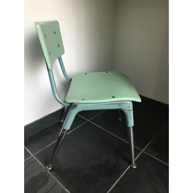 vintage industrial Childs chair from designer's home. Perfect for boy's desk or play area. This is a collectors item....