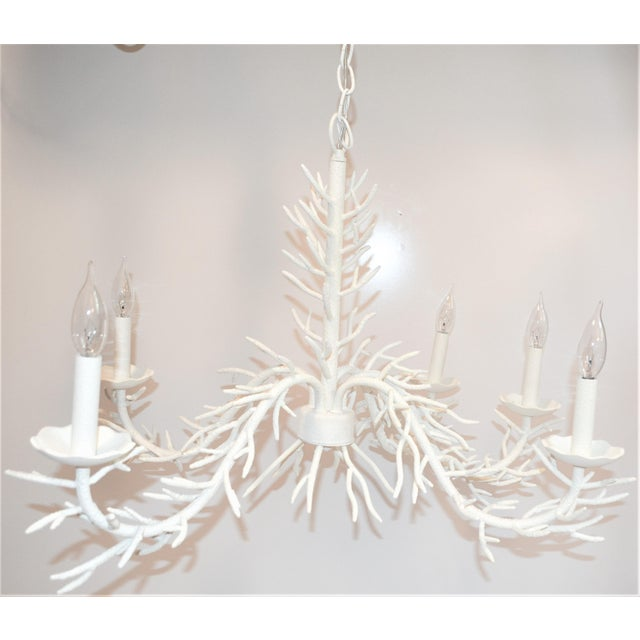 This is a beautiful faux coral 5 arm chandelier. It features dozens of tines and hand sculptured steel finished off in a...