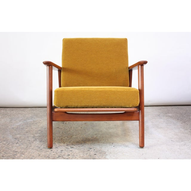 1960s Danish lounge chair with wide, sculptural arms and ochre mohair cushions. Features slight reclining function (the...