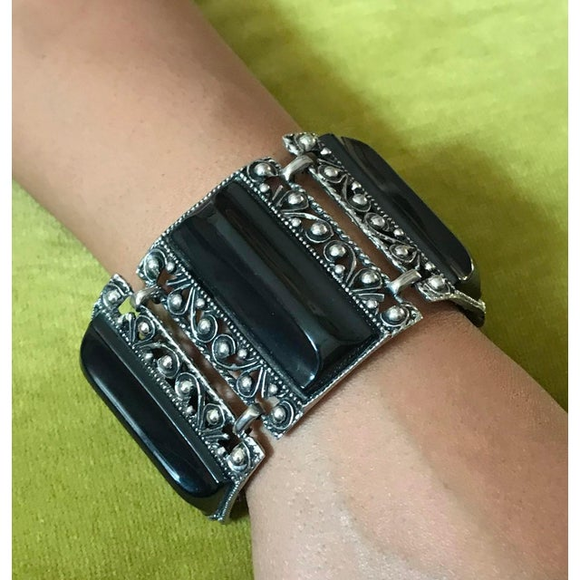 C1950s ornate silver tone metal, large link bracelet set with black thermoset Lucite pieces. It is a large, statement...