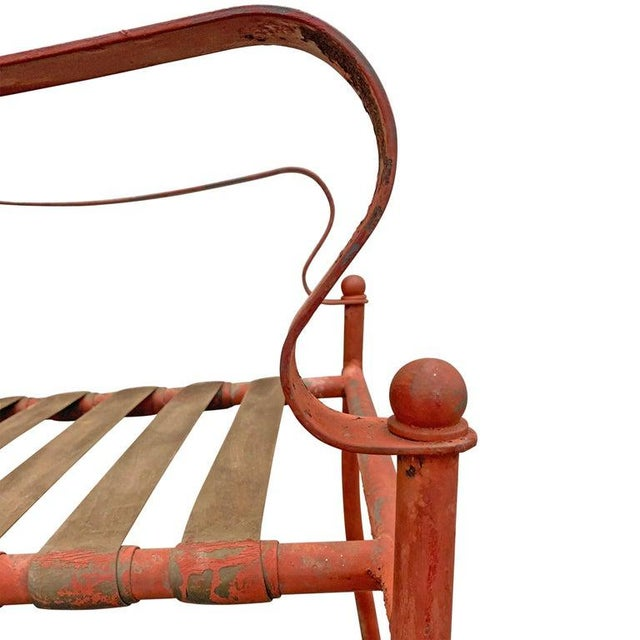 A wonderful set of four mid-20th century American iron frame patio chairs with fantastic scrolled arms, and tubular...