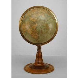 American Victorian (circa 1880) globe of the world with a brass meridian and raised on a turned wood pedestal and round...