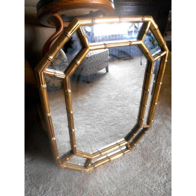 This is a Gorgeous Vintage Mid-Century Modern Hollywood Regency Faux Bamboo Gold Designer Wall Mirror. It is gold, not...