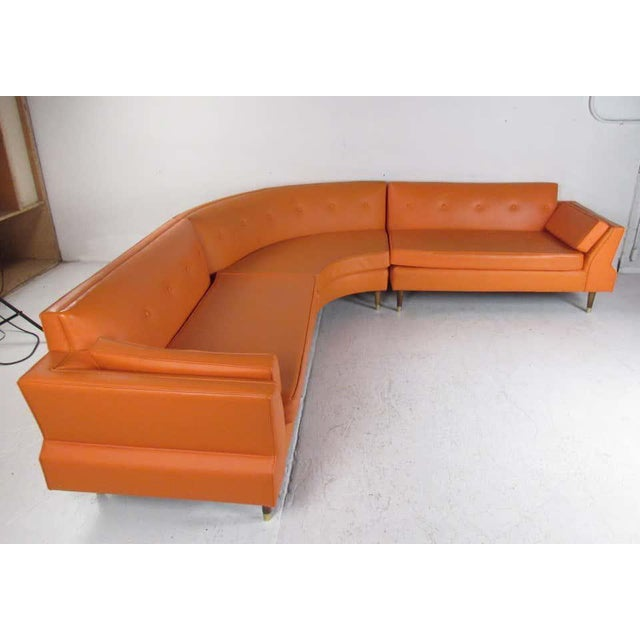 This amazing vintage modern three-piece sectional features an elaborate orange tufted vinyl upholstery. The overstuffed...