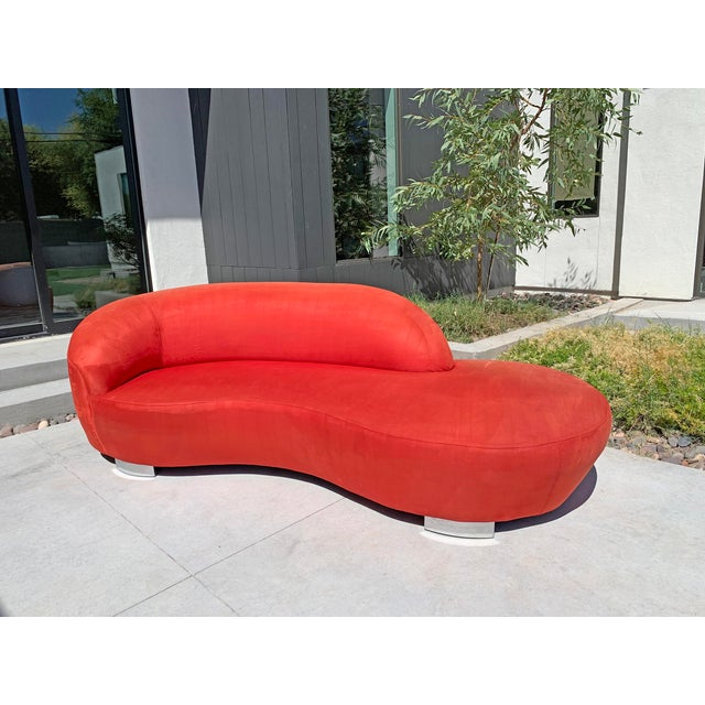 A stunning Vladimir Kagan cloud sofa in red. The sofa is in good vintage condition with a uniform fading along the back...