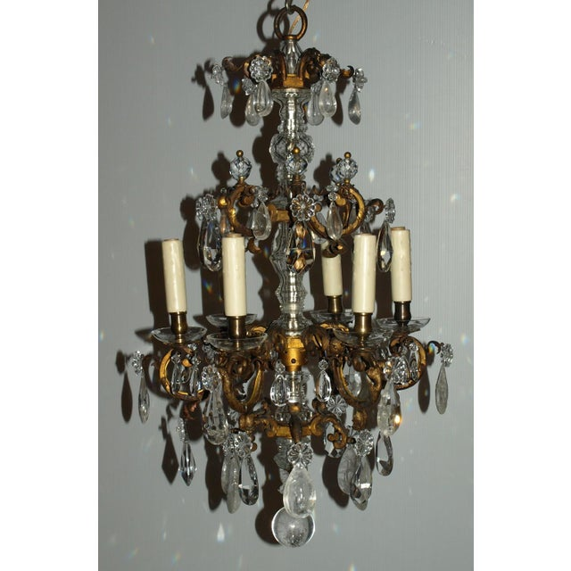 Very fine gilt bronze and rock crystal cage style chandelier, six lights