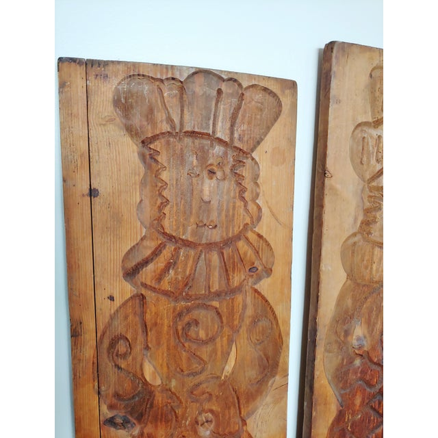 This is a fun pair of hand carved stylized royal subjects, prince and princess? They appear to be wood molds. Similar in...
