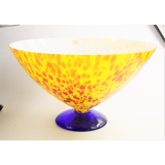 "Sasaki pedestal art glass bowl in red, yellow & cobalt blue. @ 7-1/4"" high x 12-1/2"" diameter and @ 5"" at the base...."