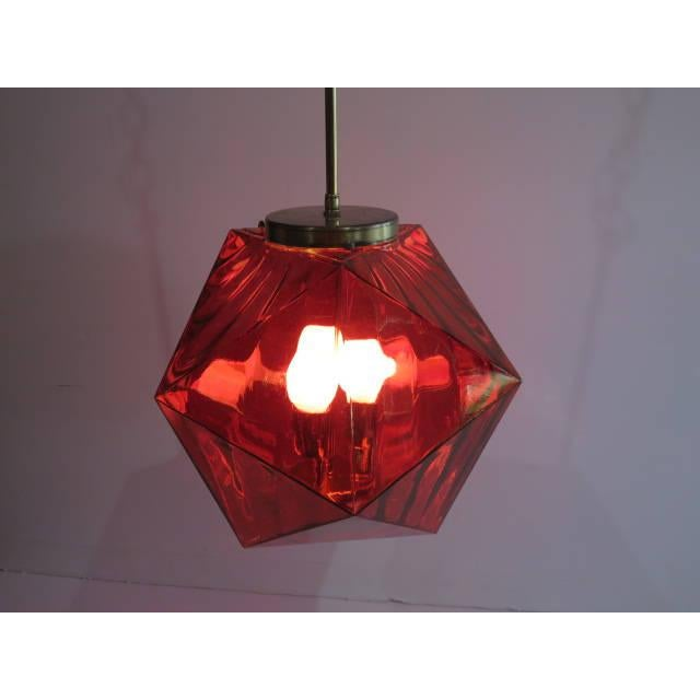 Of the period: mid-century modern date of manufacture: 1970s materials: cranberry colored glass with three candelabra...