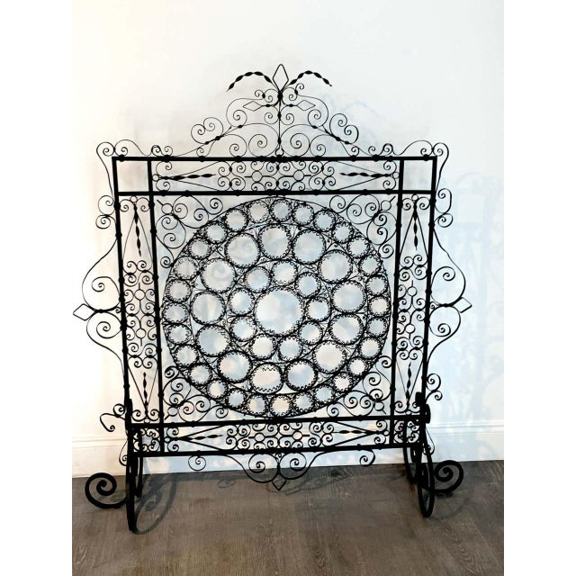 High Victorian wrought iron wire work medallion fires screen, a substantial screen with intricate wrought iron wire work,...