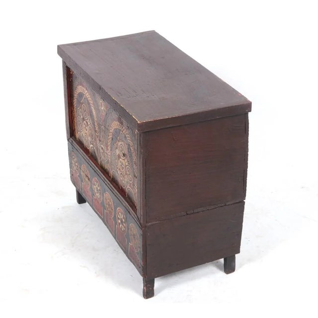 Moroccan hand painted wood chest, the front panels are hand painted with arabesques, raised up legs, from the 19th century.