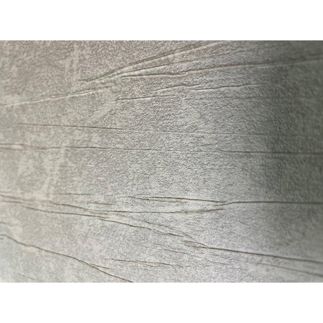 Cedar crinkle pattern wall covering. Non woven back. Class A Type II Vinyl. Manufacturer: RJF Made Between: 2010-2020...