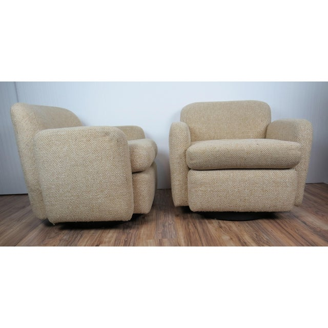 Rare pair of swivel armchairs attributed to Vladimir Kagan for Weiman Preview. Diminutive size ideal for urban spaces....