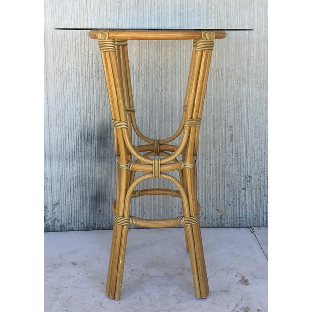 About 20th century set of four high round cocktail table in faux bamboo with glass top Measurements of glass top: 35.75in...