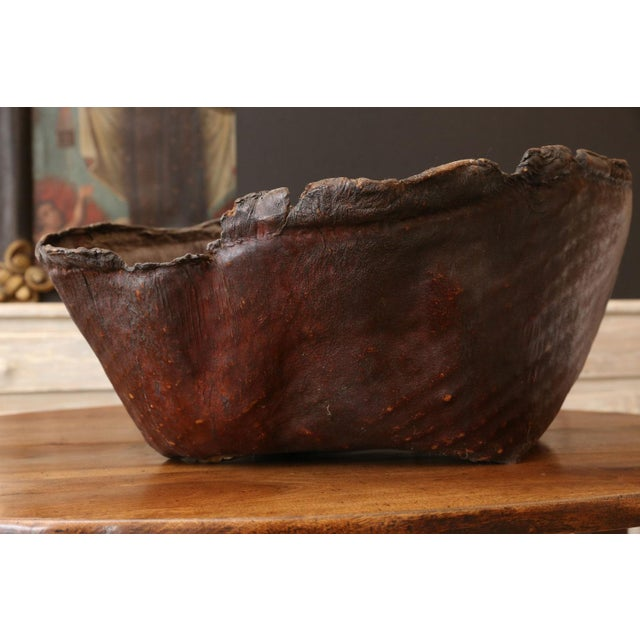 Antique primitive hide basket: frayed-edge, natural-shaped basket of hardened leather. Makes an excellent near-pair with...