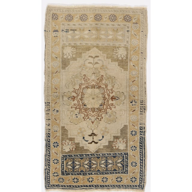 Vintage Turkish rug, circa 1940s. Features a warm color palette and handwoven of high-quality wool. Colors-cream/soft...