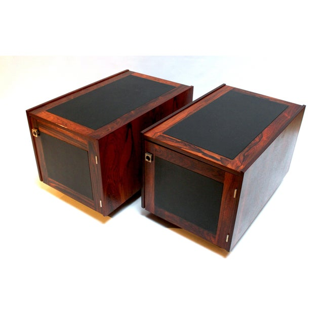 Pair of 1960s Danish modern rosewood and leather side tables by Bornholm. Tables have doors on one side with metal pulls...