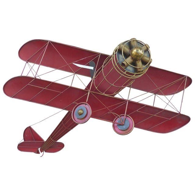 Large Three Dimensional Iron and Brass Wall Sculpture of an Airplane in Flight For Sale