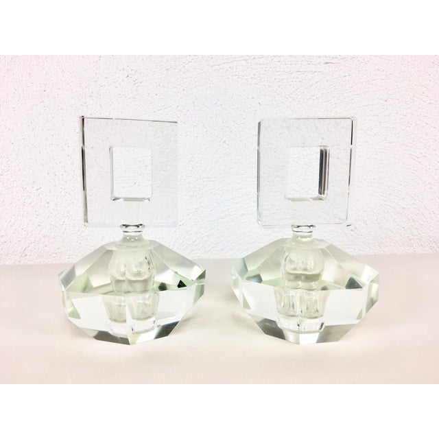 This is a pair of Parisian perfume bottles, hand cut leaded crystal circa 1950, With a square cut stopper. Condition is...