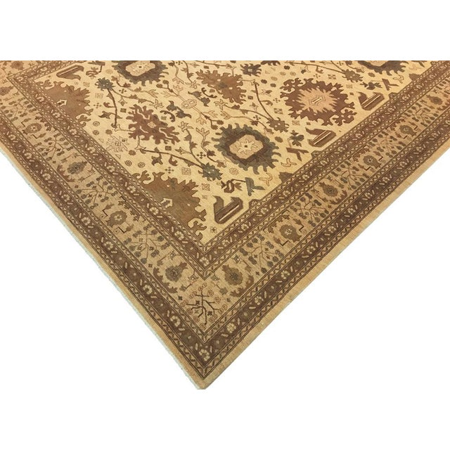 This elegant rust rug features luxurious wool construction that adds comfort and style to any decor. The rug features an...