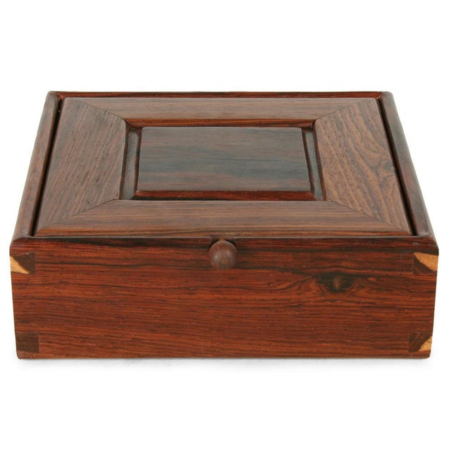 An American craft studio Rosewood jewelry box in a perfect square form with beautiful joinery, inset square panel detail...