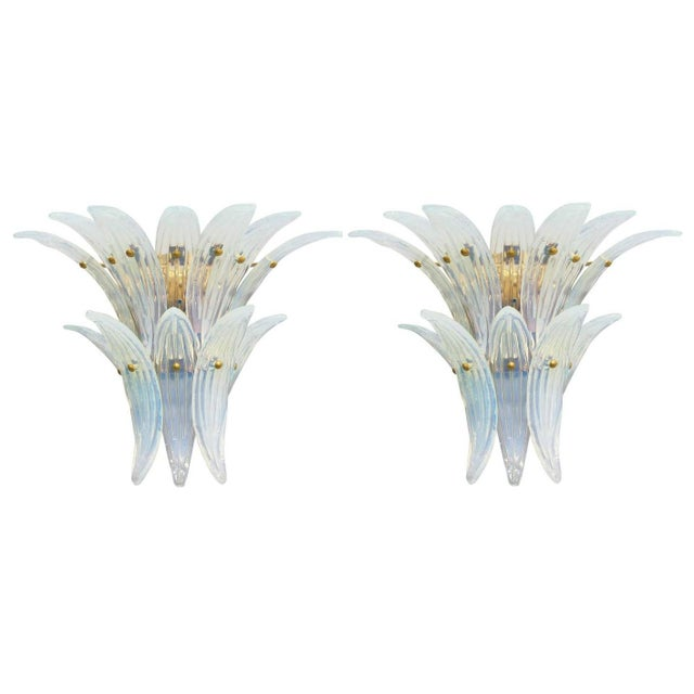 Limited edition Italian Palmette wall sconces shown with 12 opaline Murano glass leaves mounted on antiqued brass finish...