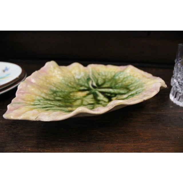 Unique 1980s ridged Majolica platter in the form of a leaf in pink, yellow, and green.