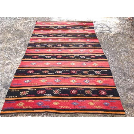 This beautiful, vintage, handwoven kilim is approximately 60 years old. It is handmade of very fine quality in all natural...