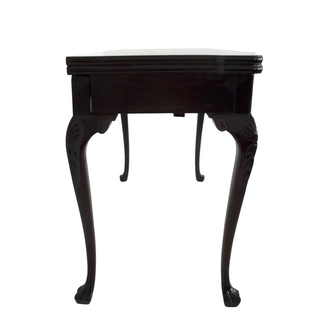 A great buy and final markdown for this classic Chippendale style mahogany console or games table with four extension...