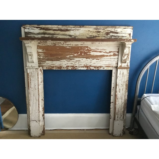 Antique wooden mantel with shelf. Very heavy. Rustic, shabby chic.