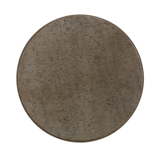 The Cork Drum Side Table Round cork clad drum table in a handsome metallic bronze finish with a metal top edge-banding in...