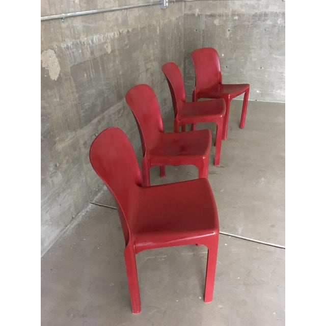 Selene Chair by Heller. These chairs have been freshly Painted (via a Spray booth) in a burgundy color. The new finish is...