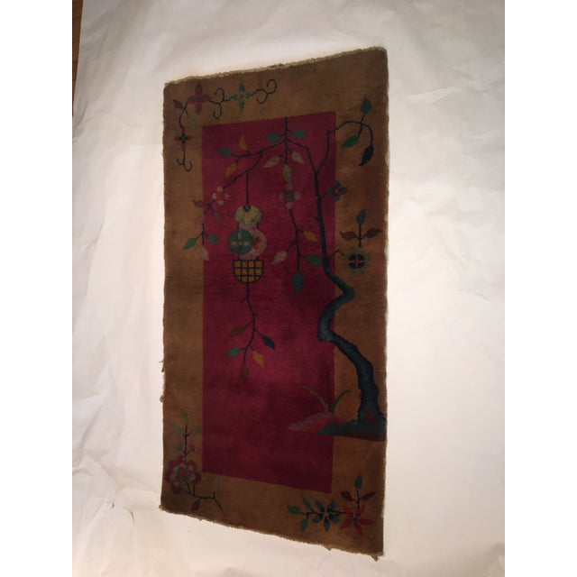 A very beautiful old Chinese wool rug in gold and deep red tones with green and other accents. A thick pile. Wonderful...