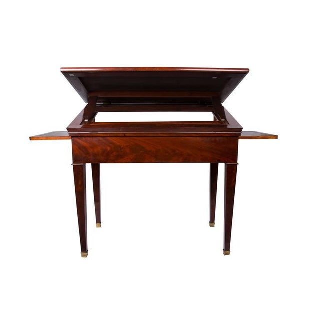 This is a superb early 19th century French Empire architect's desk and table having both a beautifully figured mahogany...