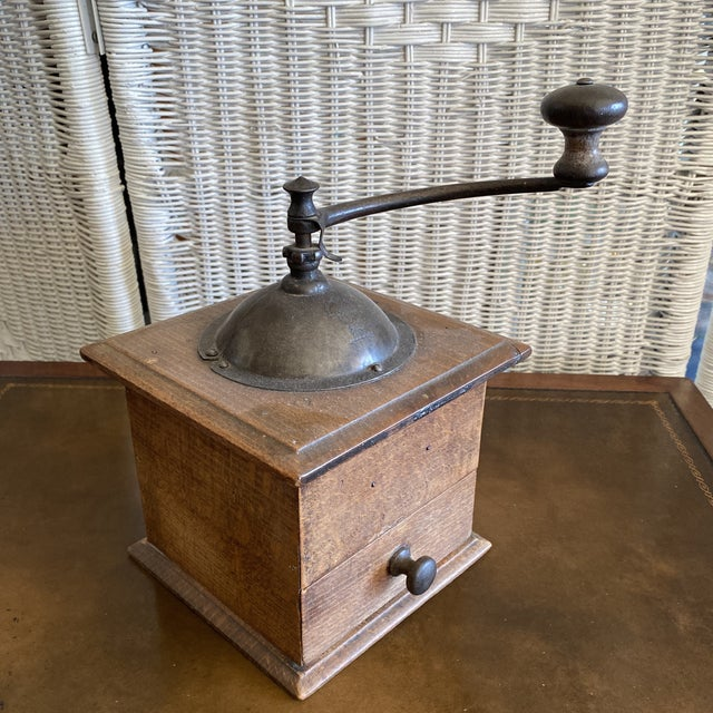 Cool antique coffee grinder or coffee mill made in France by Peugeot. Great accent piece for your kitchen or dining room....