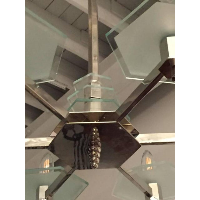"""This 1930s French Art Deco modernist chandelier has it in """"sixes"""". The bright nickel body hangs from a six sided shaft..."""