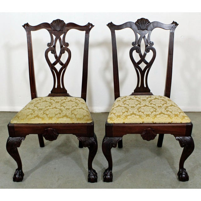 Offered is a pair of Chippendale mahogany dining chairs with ball & claw feet. They are in goodcondition, minus some...