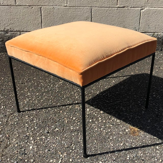 This low iron stool is an iconic mid-century modern design by Paul McCobb with a modern pop of color in new orange velvet...