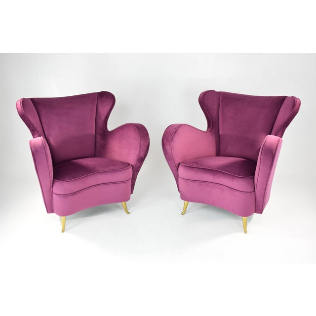 Pair of 20th-century vintage Italian curved club armchairs manufactured by ISA Bergamo. We have fully restored the seating...