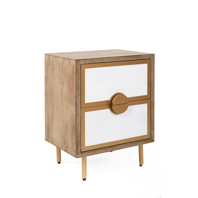 Sleek and sophisticated, our Positano Nightstand frames richly-grained wood with polished gold legs for a handsome...