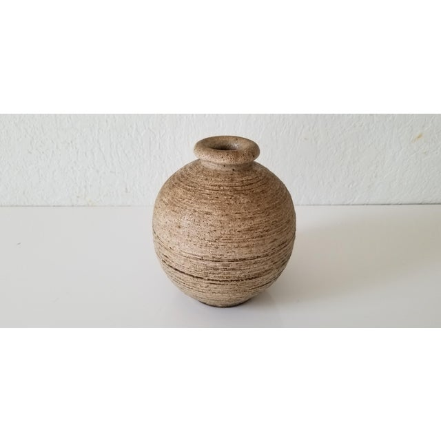 Item: For your consideration we are presenting for sale a nice round Mid-Century decorative studio pottery bud vase. Circa...