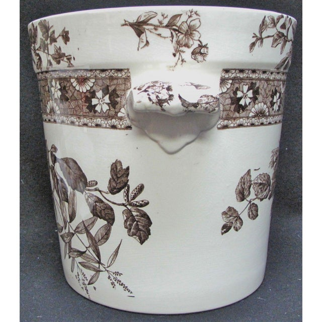 Exact age unknown, but thought to be late 1800's. Made in England. Enameled decoration on white Ironstone. Round vessel...